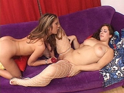 Young brunette lesbian in fishnets gets dildo fucked by mature blonde